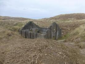 One of four surviving roofless structures thought to be the earliest known surviving group of mass-concrete magazines, dating to the 1890s